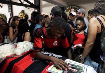 A friend reacts as he attends the funeral service for soccer player Vinicius de Barros Silva Freitas after a deadly fire at Flamengo soccer club's training center, in Volta Redonda