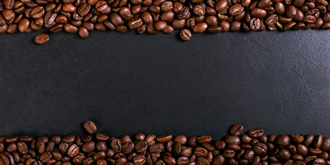 Aroma roasted coffee beans on rustic tabletop, brown banner background.