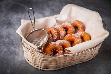 many donuts in a wicker basket, home baking, rustic style