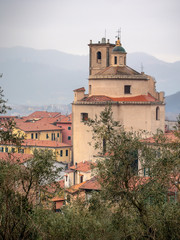 Santo Stefano Magra church and houses in Lunigiana area of Italy in La Spezia province. Vertical shot. Wintry day.