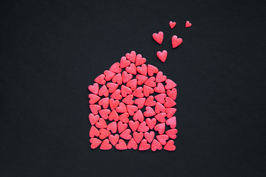Many red hearts in the form of house. House full of love concept