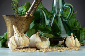 Ingredients for making pesto on a wooden table .