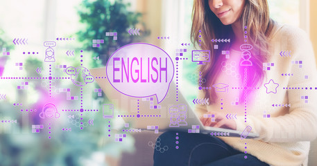 English with woman using her laptop computer