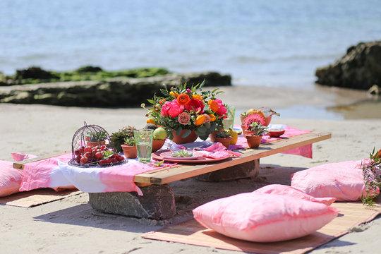 Festive table decor, beautiful event venue, creative beach wedding decor,