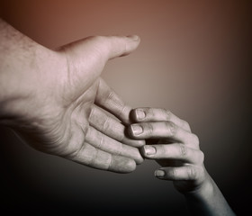 Helping hand. The human lending a helping hand another person. Black and white.