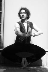 Bollywood dancer with beard and black curly hair