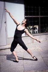 Dancer with black leotard and ballet tips