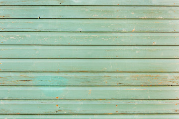 Section of light green wood panelling from a seaside beach hut. Perfect as a background for Summer Holiday or seaside themes.
