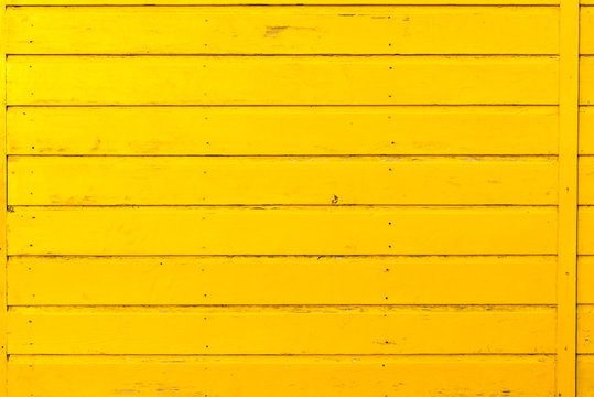 Section of yellow wood panelling from a seaside beach hut. Perfect as a background for Summer Holiday or seaside themes.