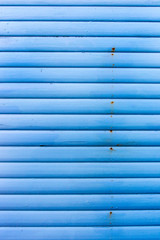 Section of light blue wood panelling from a seaside beach hut. Perfect as a background for Summer Holiday or seaside themes.