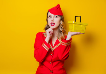stewardess wearing in red uniform with shopping basket