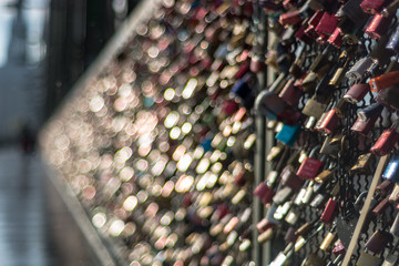 Love locks chained to bridge. Hohenzollern Bridge in Cologne, Germany.