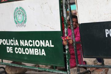 A girl holds some lollipops at the Simon Bolivar international bridge in Cucuta