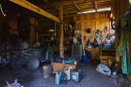 Miass, Russia, 23 July 2018: Workshop shed garage with toold for repare and atv inside