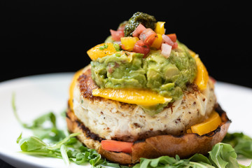Chicken Sandwich Decorated with Orange bell peppers, Tomatoes, Guacamole and Pesto