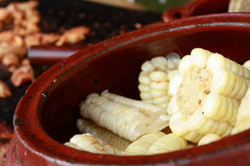 Peruvian yellow corn called 'Choclo' in handmade ceramic pot