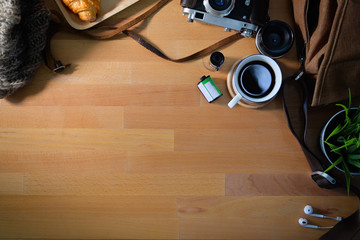 Top view of wooden workplace of photographer and copy space