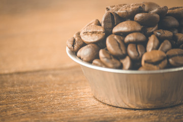Coffee beans on a wooden background. Copy space.