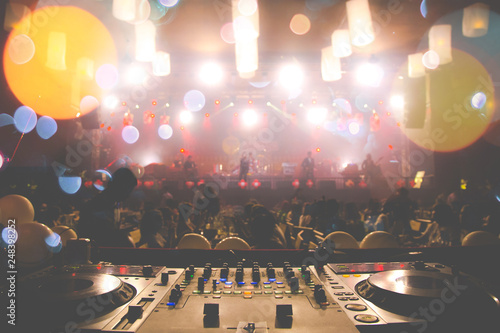DJ Spinning, Mixing, and Scratching in a Night Club, strobe