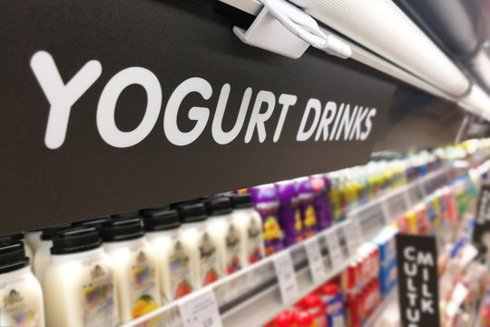 Yogurt signage at the fresh chiller refrigerated section of supermarket