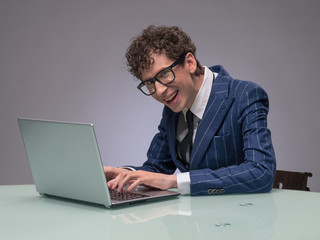 Funny man using laptop