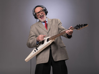 Senior man playing electric guitar