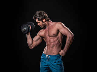 Man with bare chest lifting dumbbell