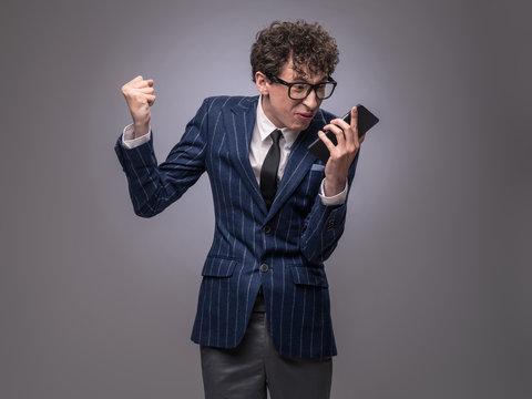 Man arguing via phone call