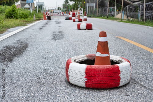 Tyres placing on road for police stop checkpoint in Thailand