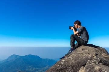 Photographer with digital camera .Travel Concept