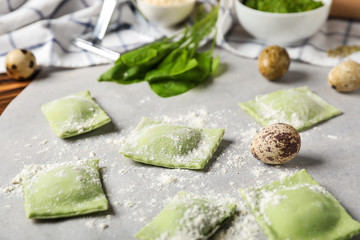 Uncooked ravioli on parchment