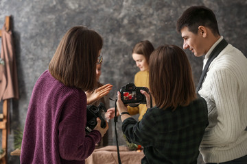 Professional photographers working together in studio
