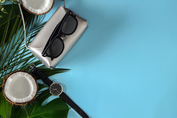 Composition with sunglasses and female accessories on color background
