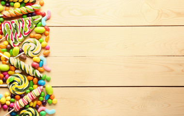 Different sweets on wooden background
