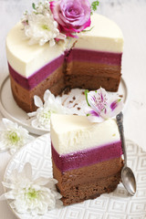 Fresh flowers decorated layered cake