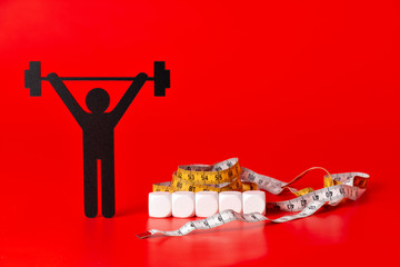 weight lifting pictogram with pills, tape measure