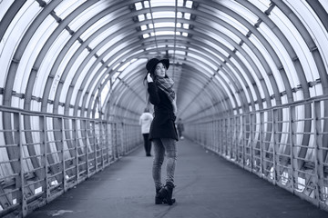 Young adult girl in the architectural tunnel