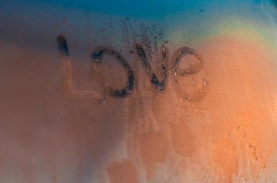 Word Love written on the foggy window