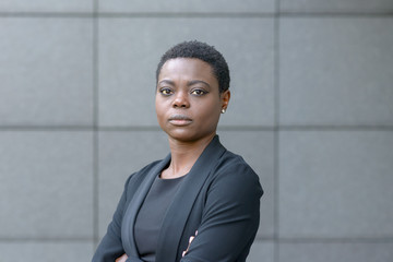 Portrait of black business lady with short hair
