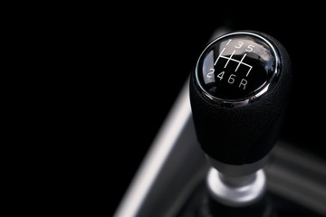 Gearbox gear stick manual control of power in car interior