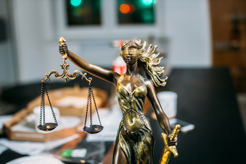 scales of justice in the office of the judge