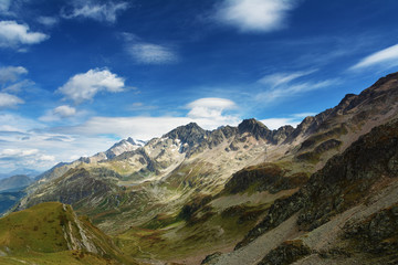 A great warm autumn in France in the Alpine mountains on tourist paths with magnificent views around.