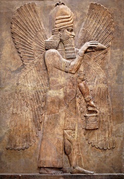 Assyrian wall relief of a winged genius