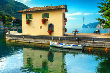 Wall Mural - Torbole harbor with fishing boat and colorful building, Garda lake