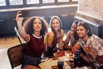 Group of friends making a selfie at restaurant