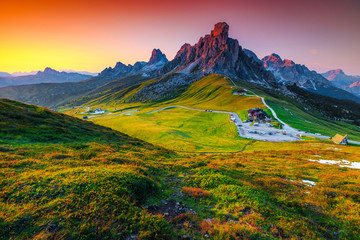 Wall Mural - Wonderful alpine pass with high peaks at sunset, Dolomites, Italy