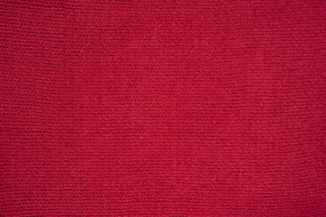 Texture of red knitted fabric.