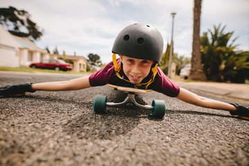 Boy playing on his skateboard