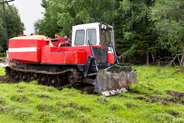 Skidding tractor in the work process