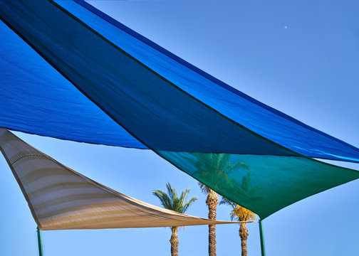 Multicolored fabric awning from the sun above the children's pool
